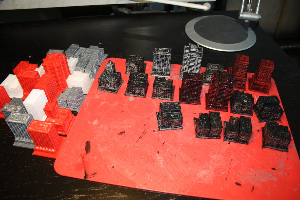 There was a lot of printing to be done, so I printed the buildings over a long period of time with whatever filament was in the printer. As a result, the first step was to paint the buildings black.